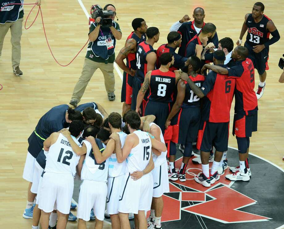 US and Argentinian players get in their teams after the formers' won 109-83 during the London 2012 Olympic Games men's semifinal basketball game between Argentina and the USA at the North Greenwich Arena in London on August 10, 2012. AFP PHOTO/EMMANUEL DUNANDEMMANUEL DUNAND/AFP/GettyImages Photo: EMMANUEL DUNAND, AFP/Getty Images / AFP