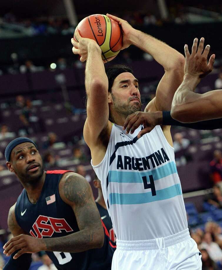 Argentinian forward Luis Scola passes the ball during the London 2012 Olympic Games men's semifinal basketball game between Argentina and the USA at the North Greenwich Arena in London on August 10, 2012. AFP PHOTO /MARK RALSTONMARK RALSTON/AFP/GettyImages Photo: MARK RALSTON, AFP/Getty Images / AFP