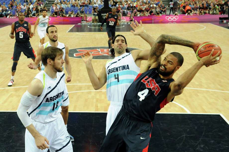 Argentinian forward Andres Nocioni (L) and Argentinian forward Luis Scola (C) challenge US centre Tyson Chandler during the London 2012 Olympic Games men's semifinal basketball game between Argentina and the USA at the North Greenwich Arena in London on August 10, 2012. AFP PHOTO/ POOL/MARK RALSTONMARK RALSTON/AFP/GettyImages Photo: MARK RALSTON, AFP/Getty Images / AFP