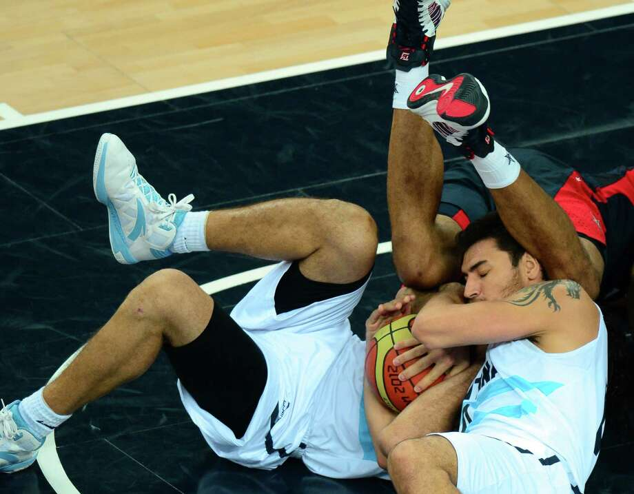 Argentinian guard Carlos Delfino vies for the ball during the London 2012 Olympic Games men's semifinal basketball game between Argentina and the USA at the North Greenwich Arena in London on August 10, 2012. AFP PHOTO /EMMANUEL DUNANDEMMANUEL DUNAND/AFP/GettyImages Photo: EMMANUEL DUNAND, AFP/Getty Images / AFP