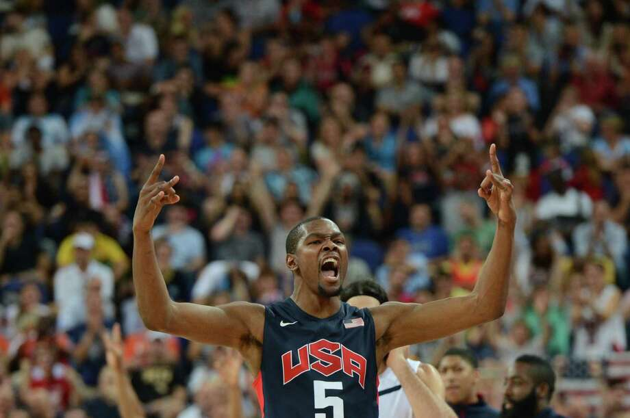 US forward Kevin Durant celebrates after scoring against Argentina during the London 2012 Olympic Games men's semifinal basketball game between Argentina and the USA at the North Greenwich Arena in London on August 10, 2012. AFP PHOTO /MARK RALSTONMARK RALSTON/AFP/GettyImages Photo: MARK RALSTON, AFP/Getty Images / AFP