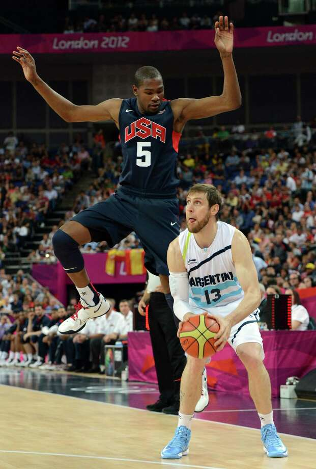 US forward Kevin Durant (L) challenges Argentinian forward Andres Nocioni during the London 2012 Olympic Games men's semifinal basketball game between Argentina and the USA at the North Greenwich Arena in London on August 10, 2012. AFP PHOTO /MARK RALSTONMARK RALSTON/AFP/GettyImages Photo: MARK RALSTON, AFP/Getty Images / AFP