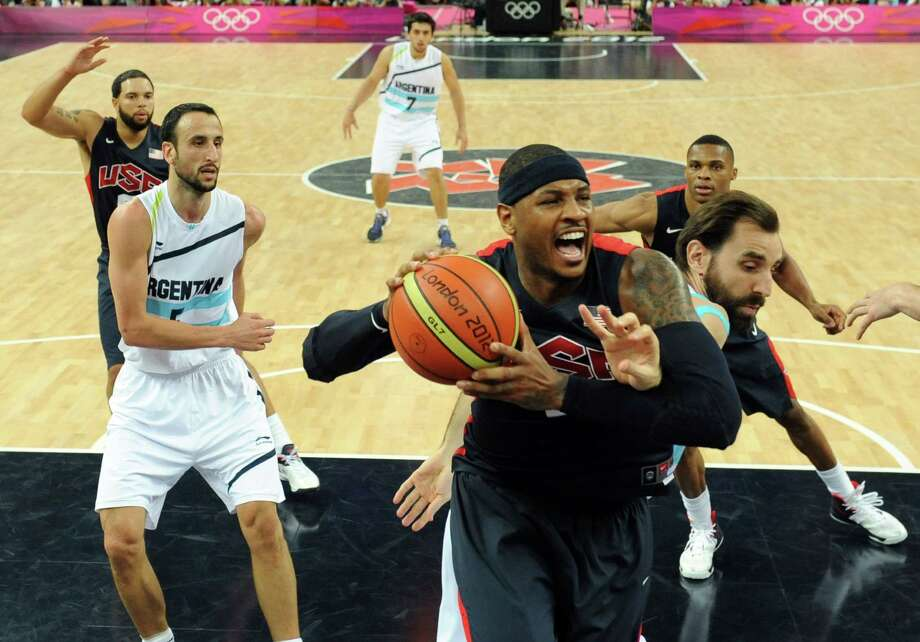 Argentina's forward Federico Kammerichs, back, challenges United States' forward Carmelo Anthony during a men's semifinal basketball game at the 2012 Summer Olympics on Friday, Aug. 10, 2012, in London. (AP Photo/Mark Ralston, Pool) Photo: Mark Ralston, Associated Press / Pool AFP
