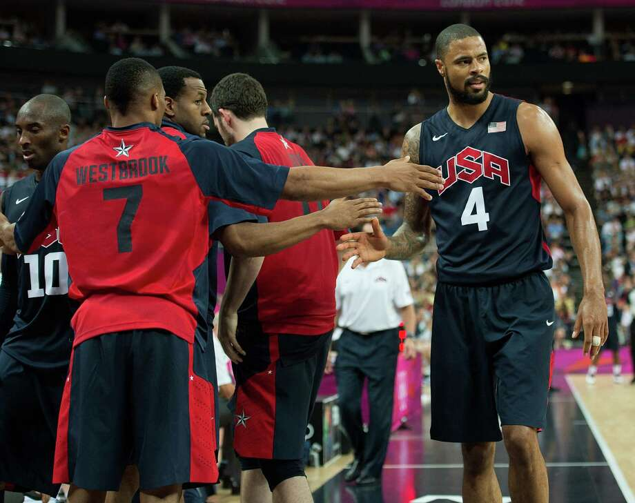USA teammates greet Tyson Chandler (4) as he comes to the bench  during their semifinals game against Argentina at the Basketball Arena at the North Greenwich Arena during the 2012 Summer Olympic Games in London, England, Thursday, August 9, 2012. USA defeated Argentina 109-83 to advance to the Gold Medal game. (Harry E. Walker/MCT) Photo: Harry E. Walker, McClatchy-Tribune News Service / Harry E. Walker, Copyright 2012