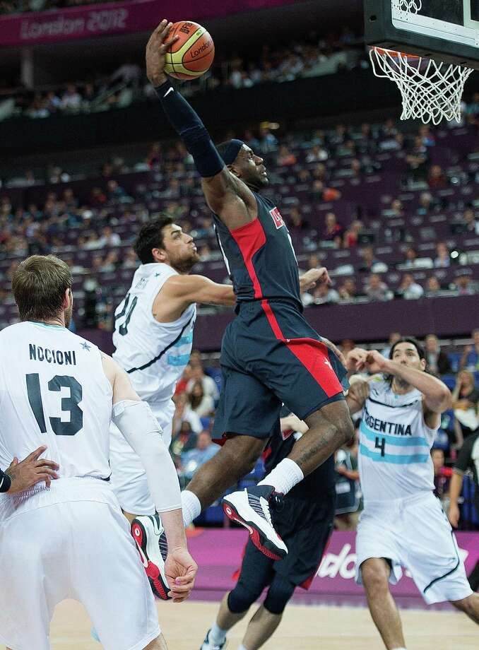 USA's Lebron James (6) goes in for a monster dunk against Argentina during their semifinals game at the Basketball Arena at the North Greenwich Arena during the 2012 Summer Olympic Games in London, England, Thursday, August 9, 2012. USA defeated Argentina 109-83 to advance to the Gold Medal game. (Harry E. Walker/MCT) Photo: Harry E. Walker, McClatchy-Tribune News Service / Harry E. Walker, Copyright 2012