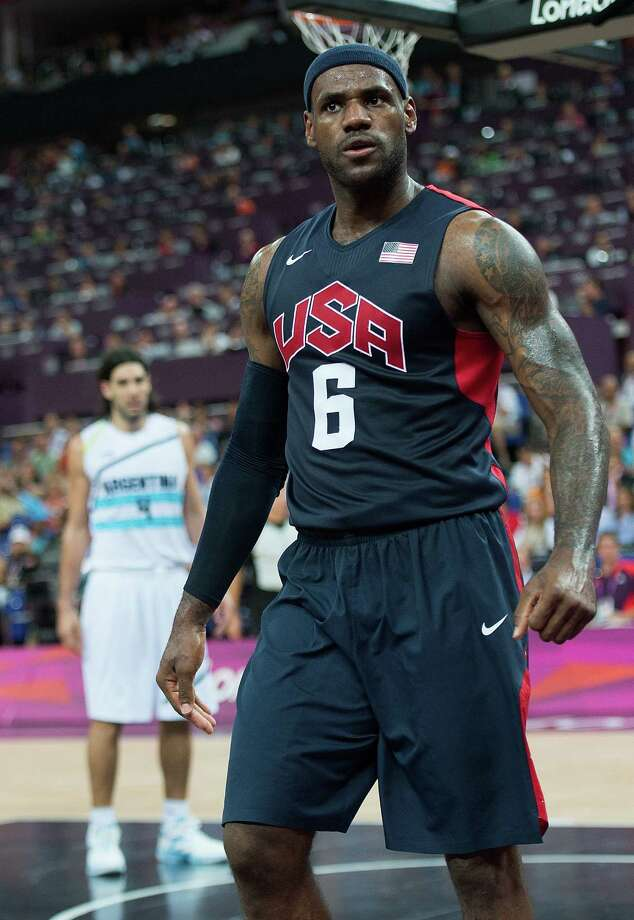 USA's Lebron James (6) poses after a monster dunk against Argentina during their semifinals game at the Basketball Arena at the North Greenwich Arena during the 2012 Summer Olympic Games in London, England, Thursday, August 9, 2012. USA defeated Argentina 109-83 to advance to the Gold Medal game. (Harry E. Walker/MCT) Photo: Harry E. Walker, McClatchy-Tribune News Service / Harry E. Walker, Copyright 2012