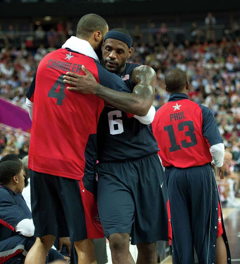 USA's Lebron James (6) gets a hug from teammate Tyson Chandler (4) in the closing moments during their semifinals game against Argentina at the Basketball Arena at the North Greenwich Arena during the 2012 Summer Olympic Games in London, England, Thursday, August 9, 2012. USA defeated Argentina 109-83 to advance to the Gold Medal game. (Harry E. Walker/MCT) Photo: Harry E. Walker, McClatchy-Tribune News Service / Harry E. Walker, Copyright 2012