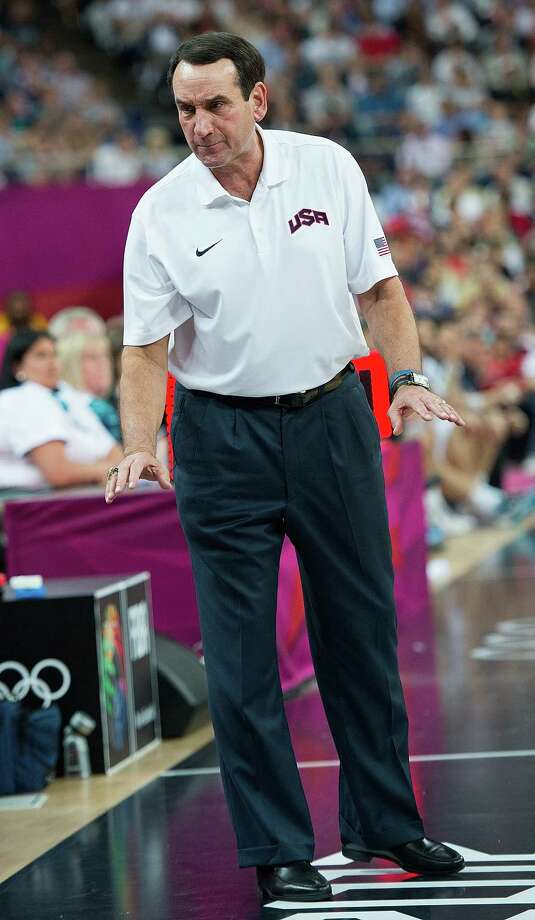 USA's coach Michael Krzyzewski urges his team not to celebrate to early  during their semifinals game against  Argentina at the Basketball Arena at the North Greenwich Arena during the 2012 Summer Olympic Games in London, England, Thursday, August 9, 2012. USA defeated Argentina 109-83 to advance to the Gold Medal game. (Harry E. Walker/MCT) Photo: Harry E. Walker, McClatchy-Tribune News Service / Harry E. Walker, Copyright 2012