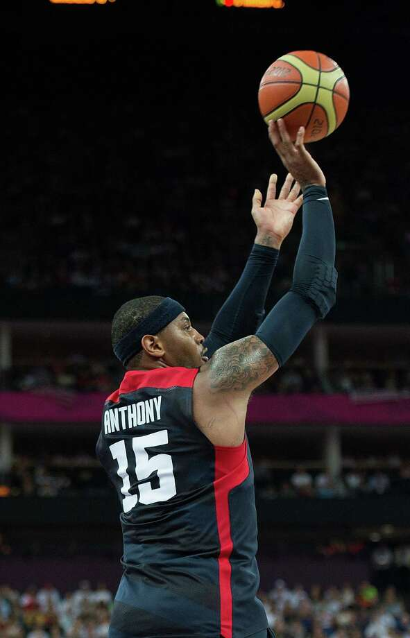 USA's Carmelo Anthony (15) shoots and hits a three-point shot during their semifinals game against Argentina at the Basketball Arena at the North Greenwich Arena during the 2012 Summer Olympic Games in London, England, Thursday, August 9, 2012. USA defeated Argentina 109-83 to advance to the Gold Medal game. (Harry E. Walker/MCT) Photo: Harry E. Walker, McClatchy-Tribune News Service / Harry E. Walker, Copyright 2012