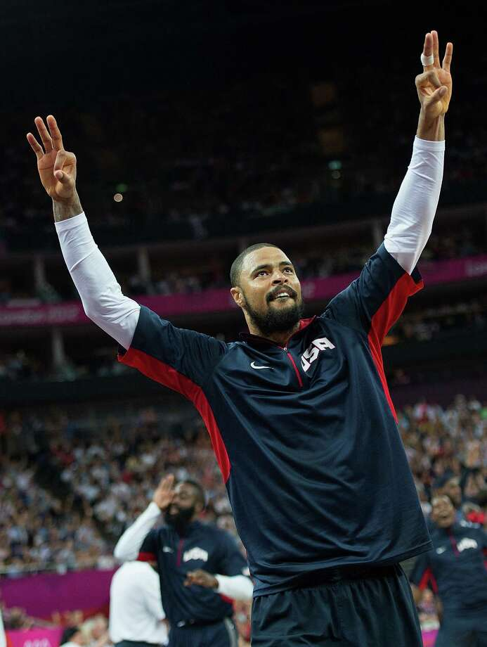 USA's Tyson Chandler (4) celebrates on the bench after teammate Carmelo Anthony (15) hit series of three-point shots against Argentina during their semifinals game at the Basketball Arena at the North Greenwich Arena during the 2012 Summer Olympic Games in London, England, Thursday, August 9, 2012. USA defeated Argentina 109-83 to advance to the Gold Medal game. (Harry E. Walker/MCT) Photo: Harry E. Walker, McClatchy-Tribune News Service / Harry E. Walker, Copyright 2012