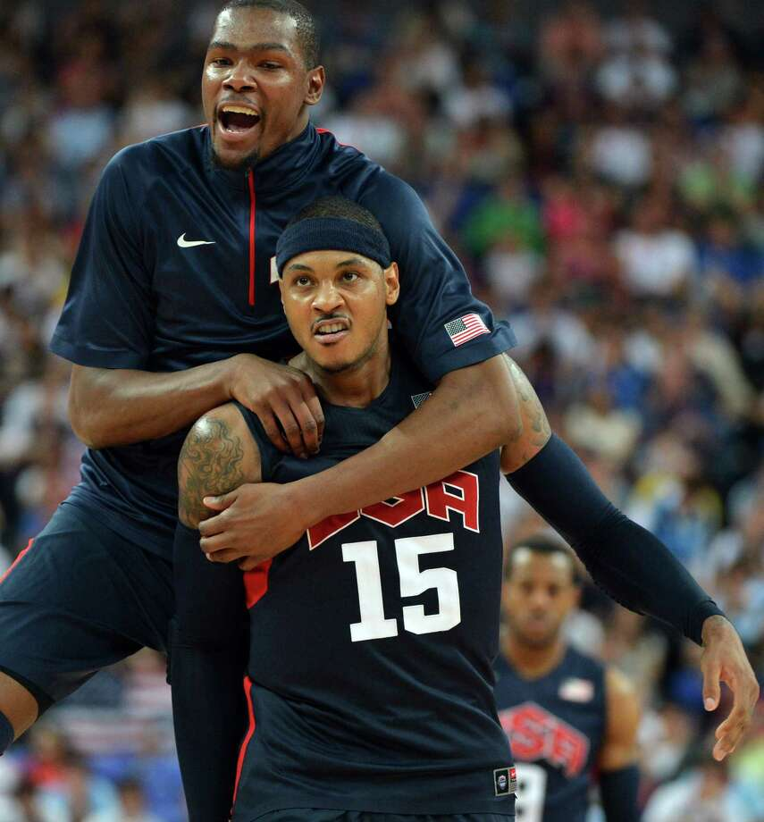 US forward Carmelo Anthony (R) celebrates with US forward Kevin Durant after winning 109-83 against Argentina during the London 2012 Olympic Games men's semifinal basketball game between Argentina and the USA at the North Greenwich Arena in London on August 10, 2012. AFP PHOTO /MARK RALSTONMARK RALSTON/AFP/GettyImages Photo: MARK RALSTON, AFP/Getty Images / AFP