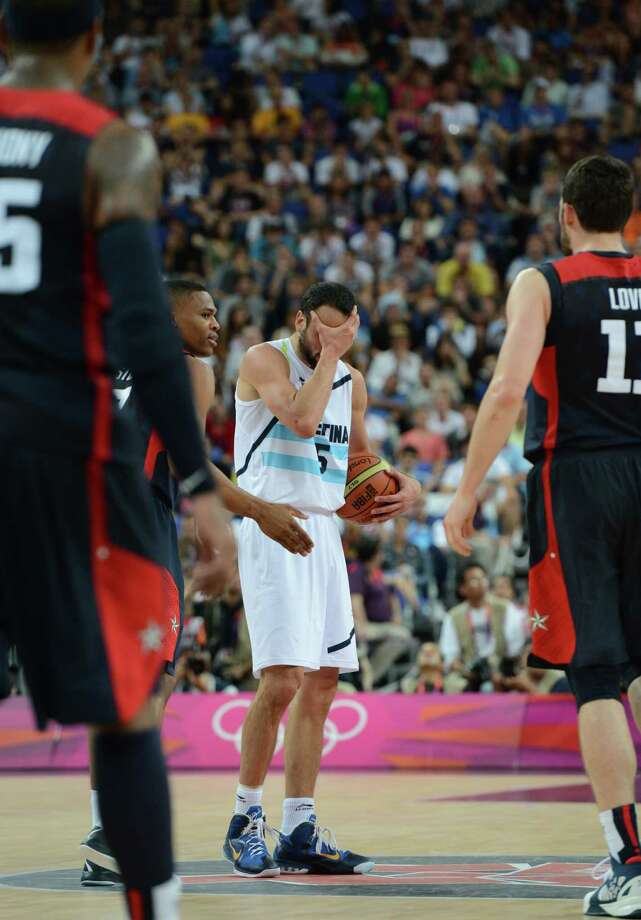 Argentinian guard Emanuel Ginobili  (C) reacts during the London 2012 Olympic Games men's semifinal basketball game between Argentina and the USA at the North Greenwich Arena in London on August 10, 2012. AFP PHOTO /MARK RALSTONMARK RALSTON/AFP/GettyImages Photo: MARK RALSTON, AFP/Getty Images / AFP