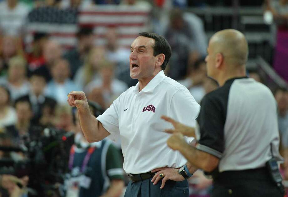 US coach Michael Krzyzewski gives instructions to his players during the London 2012 Olympic Games men's semifinal basketball game between Argentina and the USA at the North Greenwich Arena in London on August 10, 2012. AFP PHOTO /MARK RALSTONMARK RALSTON/AFP/GettyImages Photo: MARK RALSTON, AFP/Getty Images / AFP