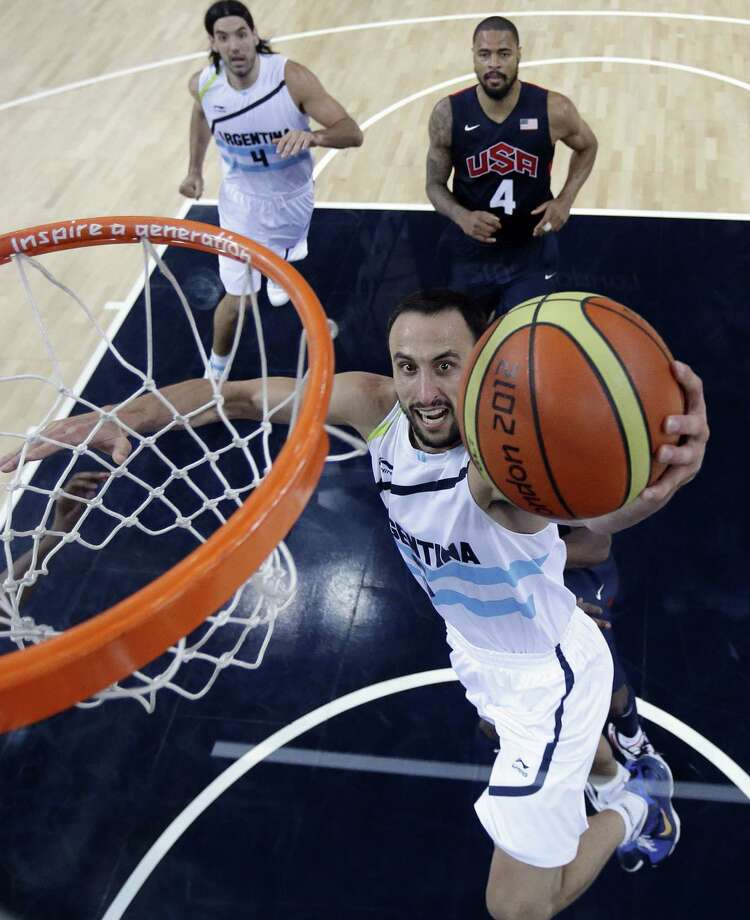 Argentina's Manu Ginobili (C) scores as teammate Argentina's Luis Scola (L) and Tyson Chandler of the US look on during the London 2012 Olympic Games men's semifinal basketball game between Argentina and the USA at the North Greenwich Arena in London on August 10, 2012. AFP PHOTO /POOL/ERIC GAYERIC GAY/AFP/GettyImages Photo: ERIC GAY, AFP/Getty Images / AFP