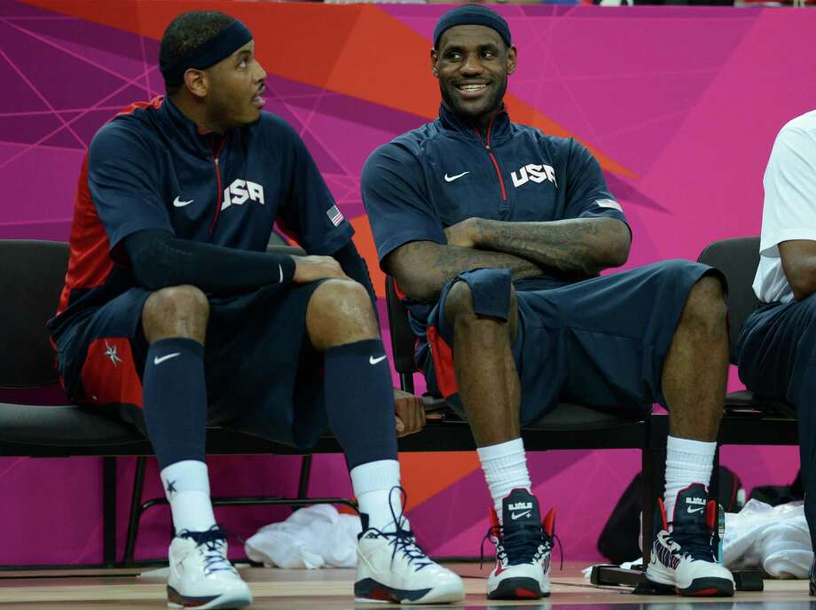 US forward Carmelo Anthony (L) and US forward LeBron James (R) sit on the sidelines at the end of the London 2012 Olympic Games men's semifinal basketball game between Argentina and the USA at the North Greenwich Arena in London on August 10, 2012. AFP PHOTO /TIMOTHY A.  CLARYTIMOTHY A. CLARY/AFP/GettyImages Photo: TIMOTHY A. CLARY, AFP/Getty Images / AFP