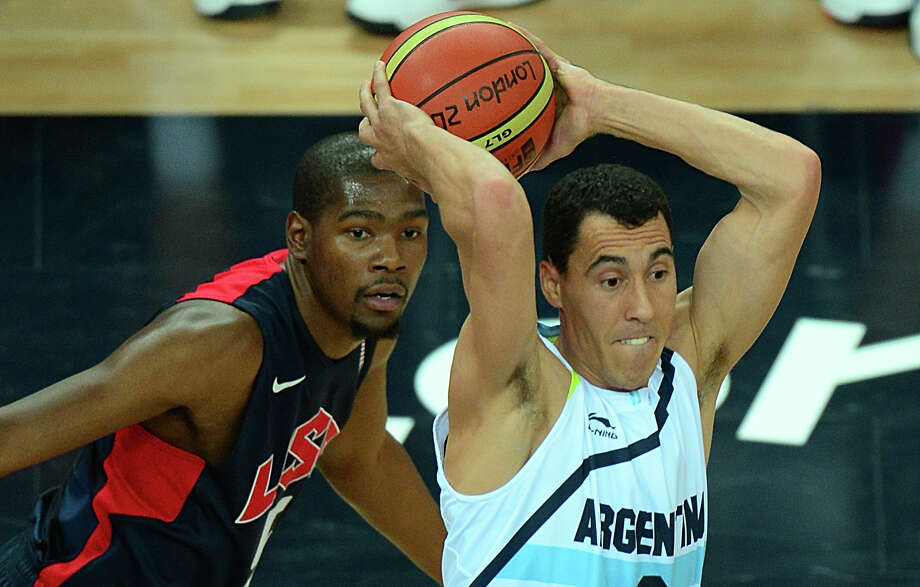 US forward Kevin Durant (L) challenged Argentinian forward Pablo Prigioni during the London 2012 Olympic Games men's semifinal basketball game between Argentina and USA at the North Greenwich Arena in London on August 10, 2012. AFP PHOTO /EMMANUEL DUNANDEMMANUEL DUNAND/AFP/GettyImages Photo: EMMANUEL DUNAND, AFP/Getty Images / AFP