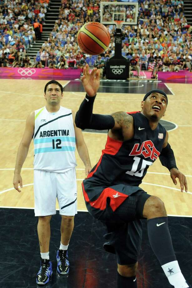 US forward Carmelo Anthony (R) shoots the ball over Argentinian centre Martin Leiva during the London 2012 Olympic Games men's semifinal basketball game between Argentina and the USA at the North Greenwich Arena in London on August 10, 2012. AFP PHOTO/ POOL/MARK RALSTONMARK RALSTON/AFP/GettyImages Photo: MARK RALSTON, AFP/Getty Images / AFP