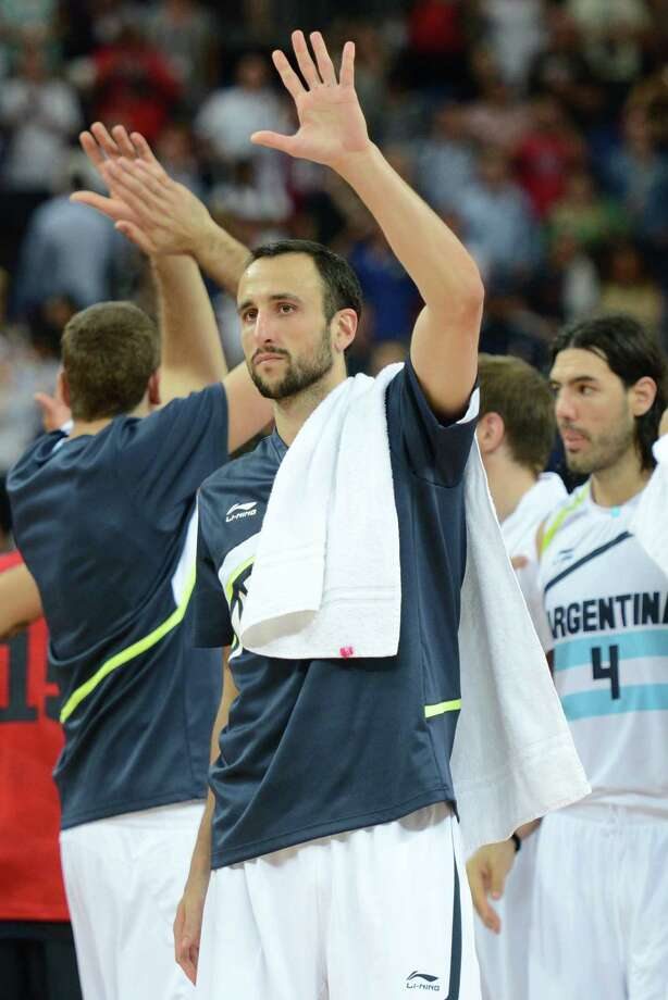 Argentinian guard Emanuel Ginobili acknowledges the crowds after losing 109-83 to the US during the London 2012 Olympic Games men's semifinal basketball game between Argentina and the USA at the North Greenwich Arena in London on August 10, 2012. AFP PHOTO /TIMOTHY A.  CLARYTIMOTHY A. CLARY/AFP/GettyImages Photo: TIMOTHY A. CLARY, AFP/Getty Images / AFP