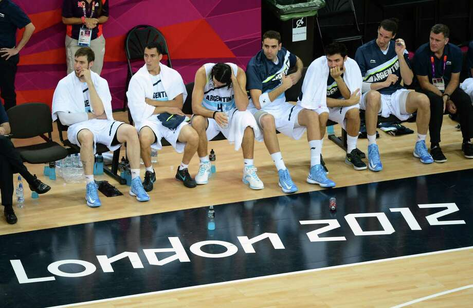 Argentinian players react after losing 109-83 to the US during the London 2012 Olympic Games men's semifinal basketball game between Argentina and the USA at the North Greenwich Arena in London on August 10, 2012. AFP PHOTO/EMMANUEL DUNANDEMMANUEL DUNAND/AFP/GettyImages Photo: EMMANUEL DUNAND, AFP/Getty Images / AFP