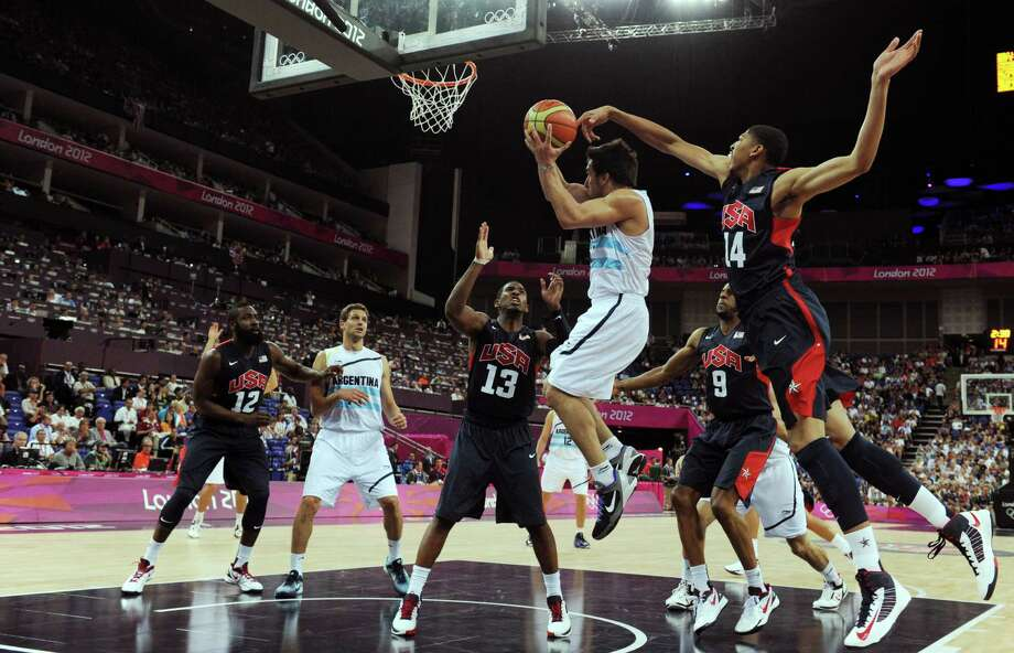US guard Chris Paul (L) and US centre Anthony Davis (R) challenge Argentinian forward Facundo Campazzo (C) as he jumps to score during the London 2012 Olympic Games men's semifinal basketball game between Argentina and the USA at the North Greenwich Arena in London on August 10, 2012. AFP PHOTO /POOL/MARK RALSTONMARK RALSTON/AFP/GettyImages Photo: MARK RALSTON, AFP/Getty Images / AFP