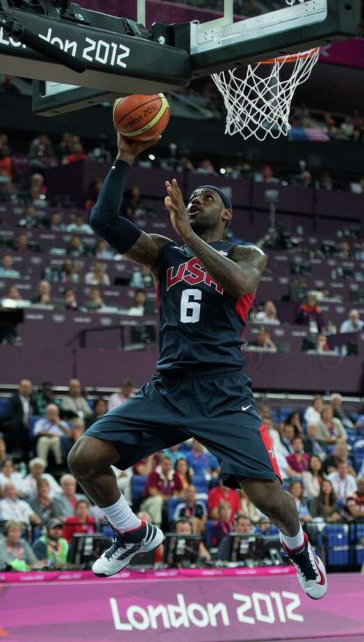 USA's Lebron James (6) scores against Argentina during their semifinals game at the Basketball Arena at the North Greenwich Arena during the 2012 Summer Olympic Games in London, England, Thursday, August 9, 2012. USA defeated Argentina 109-83 to advance to the Gold Medal game. (Harry E. Walker/MCT) Photo: Harry E. Walker, McClatchy-Tribune News Service / Harry E. Walker, Copyright 2012