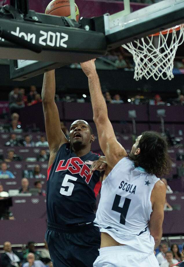 USA's Kevin Durant (5) scores on Argentina's Luis Scola (4) during their semifinals game at the Basketball Arena at the North Greenwich Arena during the 2012 Summer Olympic Games in London, England, Thursday, August 9, 2012. USA defeated Argentina 109-83 to advance to the Gold Medal game. (Harry E. Walker/MCT) Photo: Harry E. Walker, McClatchy-Tribune News Service / Harry E. Walker, Copyright 2012