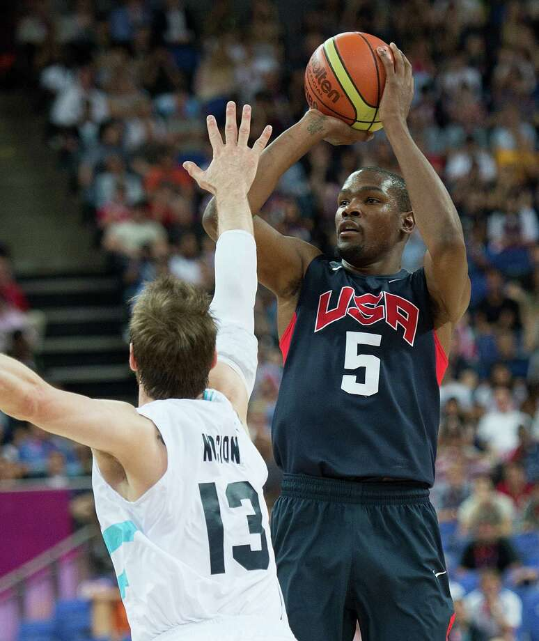 USA's Kevin Durant (5) shoots a three-point shot over Argentina's Andres Nocioni (13) during their semifinals game at the Basketball Arena at the North Greenwich Arena during the 2012 Summer Olympic Games in London, England, Thursday, August 9, 2012. USA defeated Argentina 109-83 to advance to the Gold Medal game. (Harry E. Walker/MCT) Photo: Harry E. Walker, McClatchy-Tribune News Service / Harry E. Walker, Copyright 2012