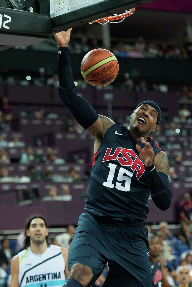 USA's Carmelo Anthony (15) slam dunks against Argentina during their semifinals game at the Basketball Arena at the North Greenwich Arena during the 2012 Summer Olympic Games in London, England, Thursday, August 9, 2012. USA defeated Argentina 109-83 to advance to the Gold Medal game. (Harry E. Walker/MCT) Photo: Harry E. Walker, McClatchy-Tribune News Service / Harry E. Walker, Copyright 2012