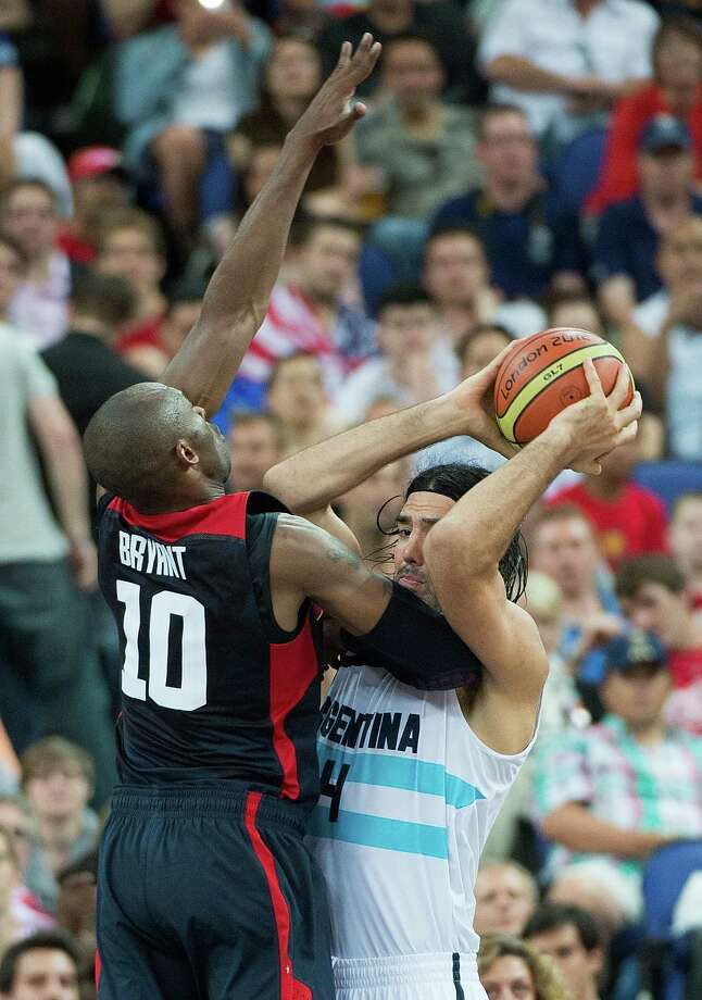 USA's Kobe Bryant (10) plays tough defense on Argentina's Luis Scola (4) during their semifinals game at the Basketball Arena at the North Greenwich Arena during the 2012 Summer Olympic Games in London, England, Thursday, August 9, 2012. USA defeated Argentina 109-83 to advance to the Gold Medal game. (Harry E. Walker/MCT) Photo: Harry E. Walker, McClatchy-Tribune News Service / Harry E. Walker, Copyright 2012