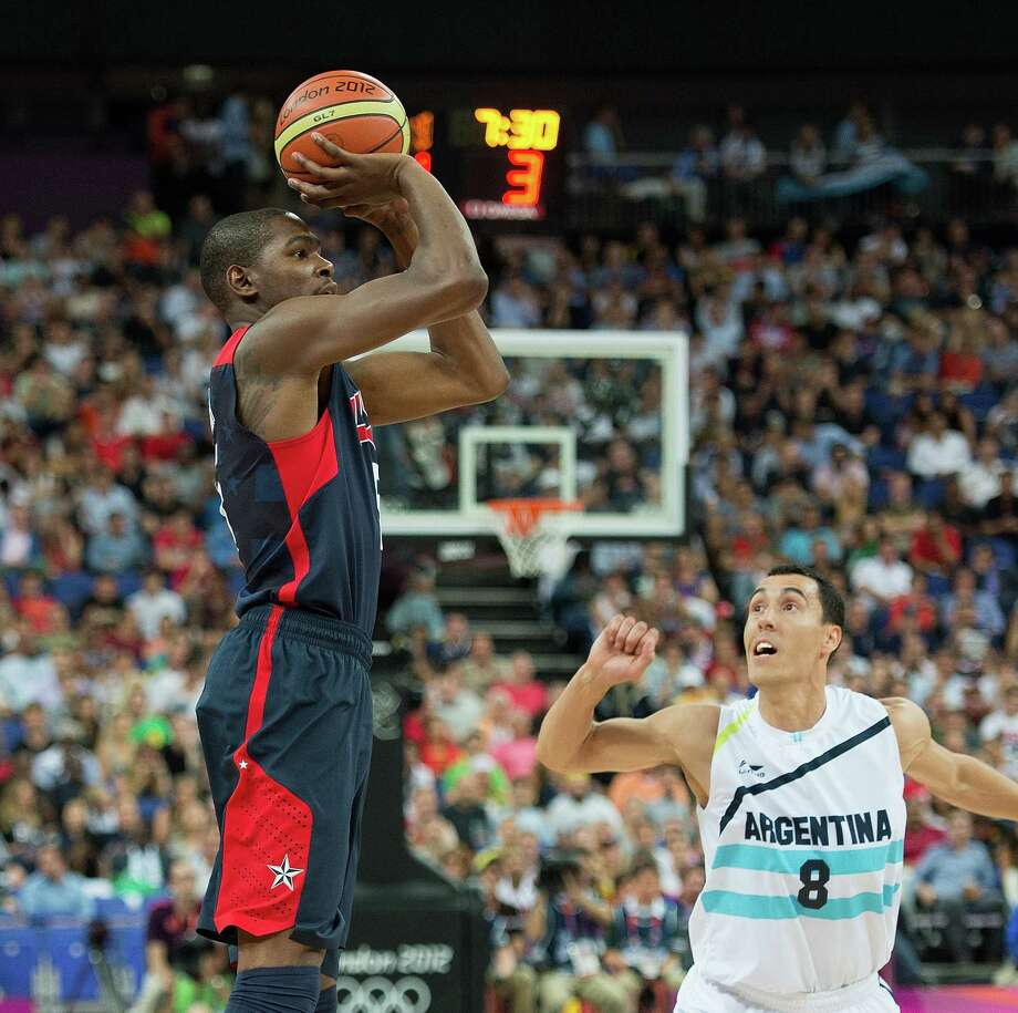 USA's Kevin Durant (5) shoots over Argentina's Pablo Prigioni (8) during their semifinals game at the Basketball Arena at the North Greenwich Arena during the 2012 Summer Olympic Games in London, England, Thursday, August 9, 2012. USA defeated Argentina 109-83 to advance to the Gold Medal game. (Harry E. Walker/MCT) Photo: Harry E. Walker, McClatchy-Tribune News Service / Harry E. Walker, Copyright 2012