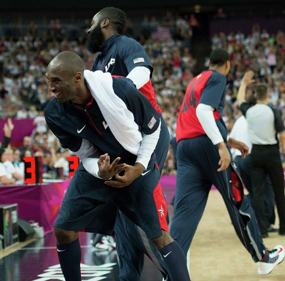 USA's Kobe Bryant (10) and others celebrate after teammate Carmelo Anthony (15) hit a series of three-point shots against Argentina  during their semifinals game at the Basketball Arena at the North Greenwich Arena during the 2012 Summer Olympic Games in London, England, Thursday, August 9, 2012. USA defeated Argentina 109-83 to advance to the Gold Medal game. (Harry E. Walker/MCT) Photo: Harry E. Walker, McClatchy-Tribune News Service / Harry E. Walker, Copyright 2012