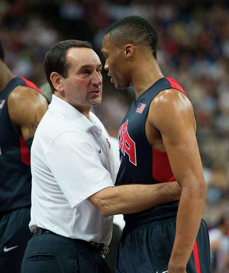 USA's coach Michael Krzyzewski hugs Russell Westbrook (7) as he came out of the game in the third period against Argentina during their semifinals game at the Basketball Arena at the North Greenwich Arena during the 2012 Summer Olympic Games in London, England, Thursday, August 9, 2012. USA defeated Argentina 109-83 to advance to the Gold Medal game. (Harry E. Walker/MCT) Photo: Harry E. Walker, McClatchy-Tribune News Service / Harry E. Walker, Copyright 2012