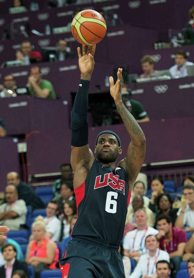 USA's Lebron James (6) shoots against Argentina during their semifinals game at the Basketball Arena at the North Greenwich Arena during the 2012 Summer Olympic Games in London, England, Thursday, August 9, 2012. USA defeated Argentina 109-83 to advance to the Gold Medal game. (Harry E. Walker/MCT) Photo: Harry E. Walker, McClatchy-Tribune News Service / Harry E. Walker, Copyright 2012