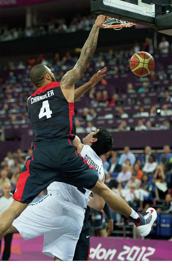 USA's Tyson Chandler (4) slam dunks on Argentina's Leonardo Gutierrez (12) during their semifinals game at the Basketball Arena at the North Greenwich Arena during the 2012 Summer Olympic Games in London, England, Thursday, August 9, 2012. USA defeated Argentina 109-83 to advance to the Gold Medal game. (Harry E. Walker/MCT) Photo: Harry E. Walker, McClatchy-Tribune News Service / Harry E. Walker, Copyright 2012