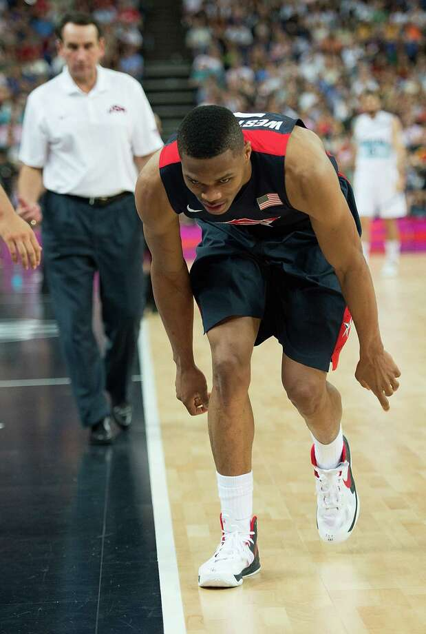 USA's Russell Westbrook (7) hobbles off the court after injuring himself during their semifinals game against Argentina at the Basketball Arena at the North Greenwich Arena during the 2012 Summer Olympic Games in London, England, Thursday, August 9, 2012. USA defeated Argentina 109-83 to advance to the Gold Medal game. (Harry E. Walker/MCT) Photo: Harry E. Walker, McClatchy-Tribune News Service / Harry E. Walker, Copyright 2012