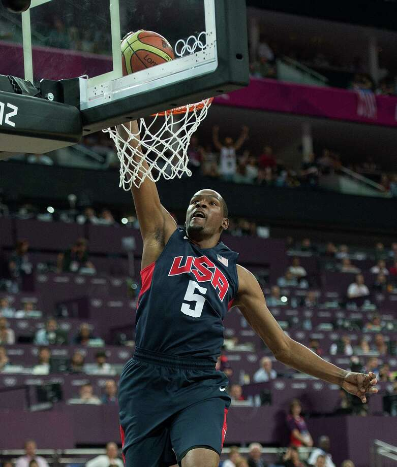 USA's Kevin Durant (5) slam dunks against Argentina during their semifinals game at the Basketball Arena at the North Greenwich Arena during the 2012 Summer Olympic Games in London, England, Thursday, August 9, 2012. USA defeated Argentina 109-83 to advance to the Gold Medal game. (Harry E. Walker/MCT) Photo: Harry E. Walker, McClatchy-Tribune News Service / Harry E. Walker, Copyright 2012