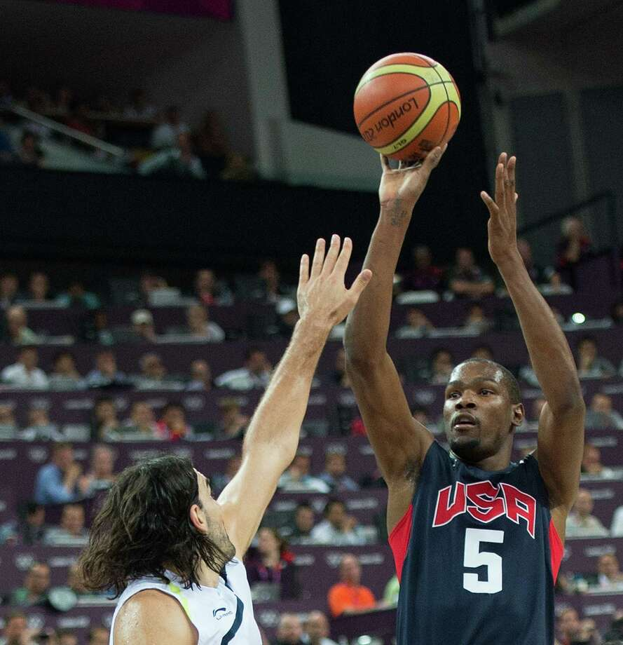 USA's Kevin Durant (5) shoots over Argentina's Luis Scola (4) during their semifinals game at the Basketball Arena at the North Greenwich Arena during the 2012 Summer Olympic Games in London, England, Thursday, August 9, 2012. USA defeated Argentina 109-83 to advance to the Gold Medal game. (Harry E. Walker/MCT) Photo: Harry E. Walker, McClatchy-Tribune News Service / Harry E. Walker, Copyright 2012