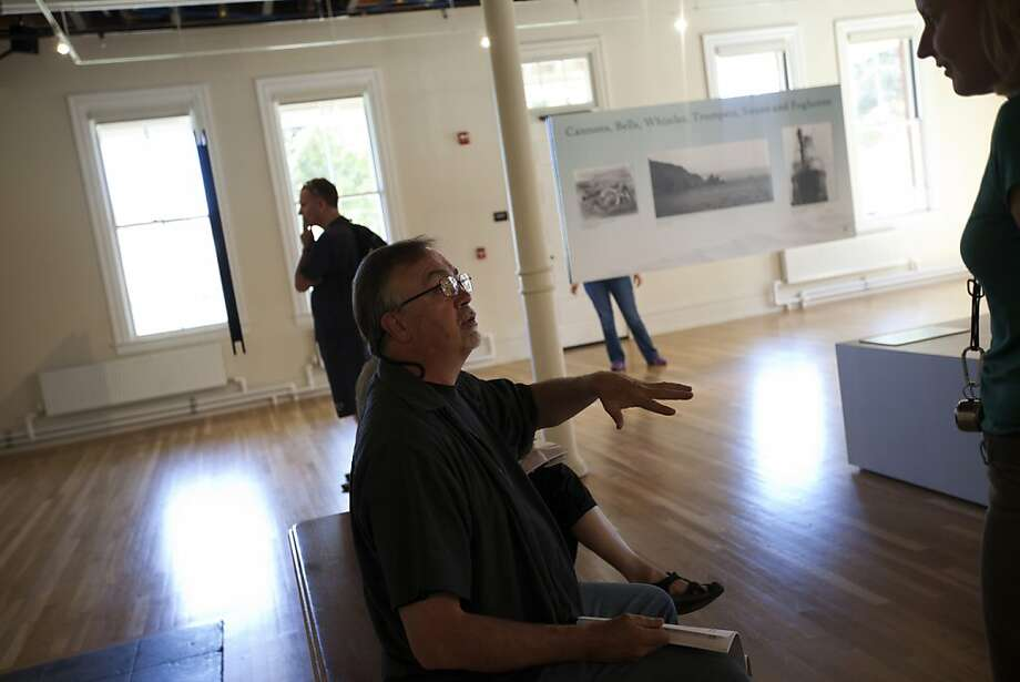"""Tim Campbell visits with Anna Pivovaroff, a guide at the Golden Gate exhibition """"Before the Bridge."""" Photo: Sonja Och, The Chronicle"""
