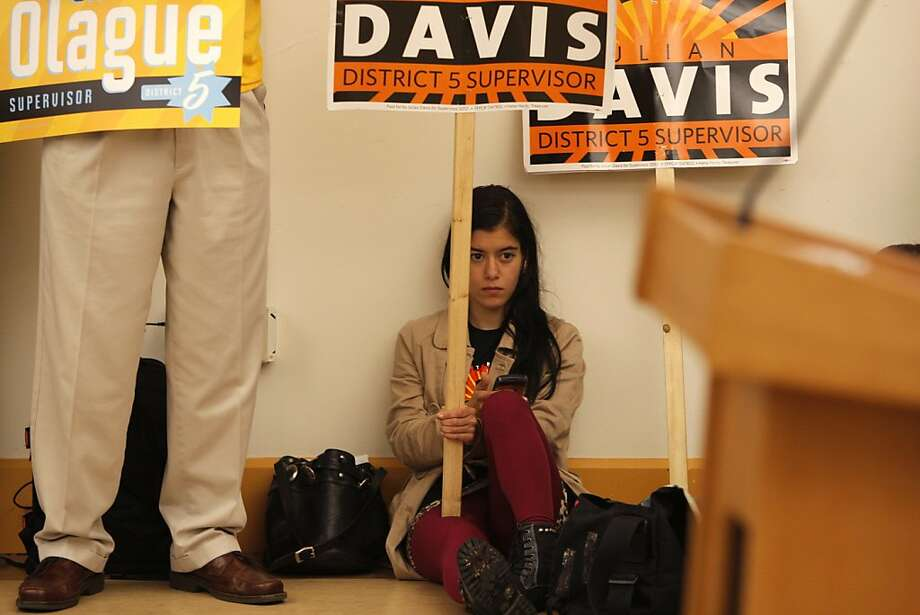 Francesca Alati holds a Julian Davis campaign sign at the first District Five supervisor candidates debate at the Park Branch Library, where the contestants' job was to show their progressive credentials. Photo: Megan Farmer, The Chronicle