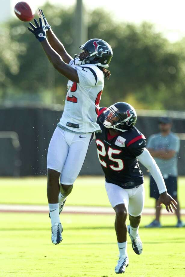 Texans receiver Keshawn Martin makes a catch over cornerback Kareem Jackson during a practice this week. Martin will start tonight in place of the injured Andre Johnson. Photo: Brett Coomer, Houston Chronicle / © 2012 Houston Chronicle