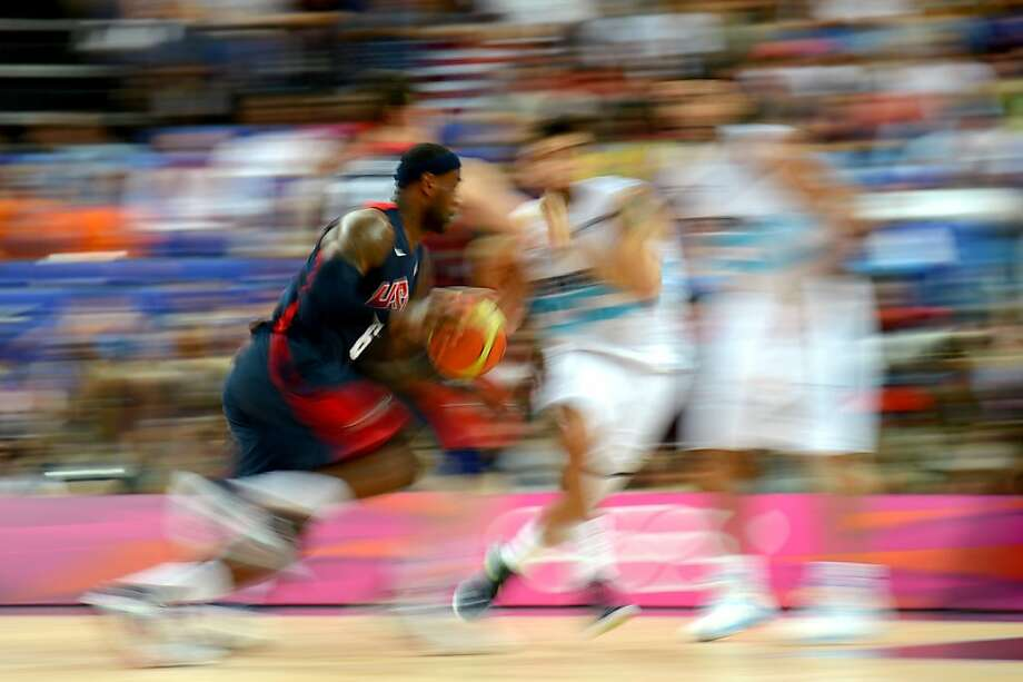 LeBron James is focused and on the move against the Argentine defense in the U.S. team's semifinal victory. James had 18 points and helped break open the game in the third quarter. Photo: Lars Baron, Getty Images