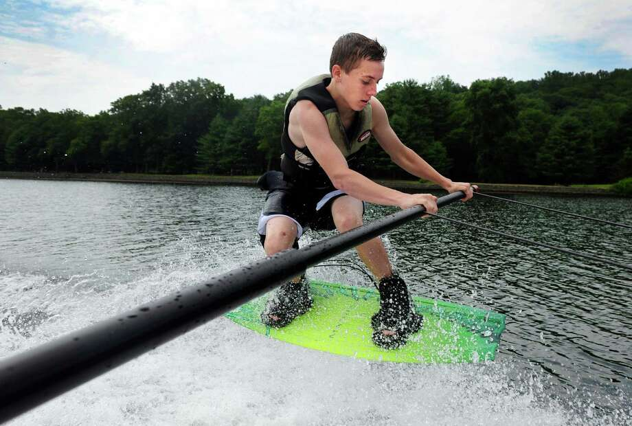 Jeff Giantonio, 17, of Durham, learns to wake board Saturday, July 7, 2012 with Gary Maynard, of waterskict.com, on the Housatonic River between Seymour and Shelton, Conn.  Maynard, of Stratford, has been giving water sport lessons on the Housatonic River since 1977. Photo: Autumn Driscoll / Connecticut Post