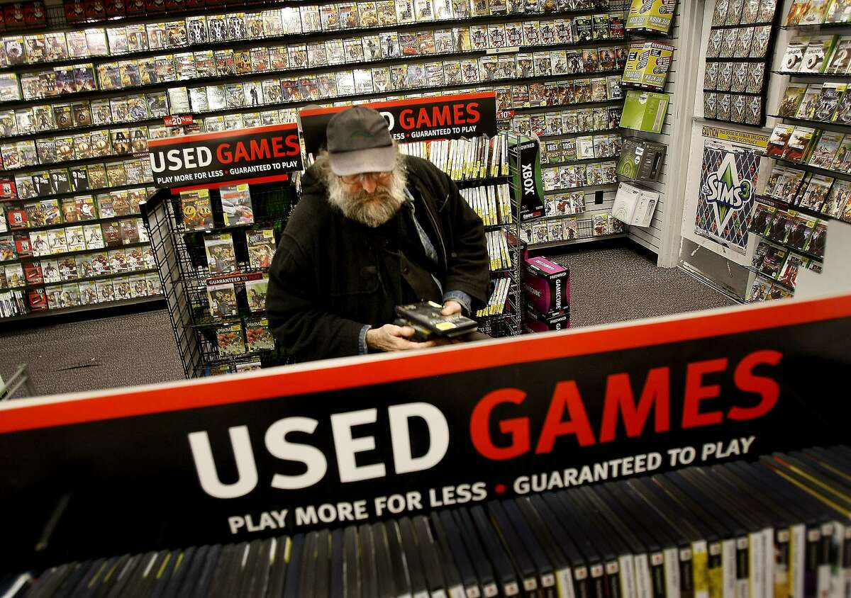 Neil Taylor of San Francisco loves games and purchased several used products at the Gamestop in San Francisco, Calif., on June 2, 2009. Used games, sold at a discount at retailers like Gamestop are a boon to consumers. Game publishers argue they don't see any profit from the resale of their product.