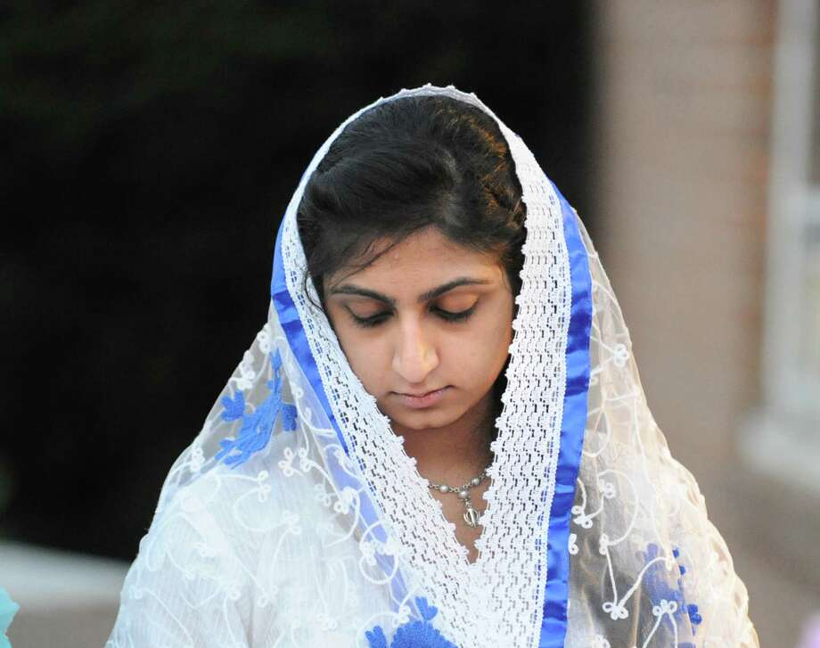 Komal Gulati of Norwalk during the Vigil and Interfaith Prayer Service at the Norwalk Gurudwara, Friday night, Aug. 10, 2012. The vigil was held in memory of the Sikh victims of the shootings that took place in the Gurudwara in Oak Creek, Wisconsin. Photo: Bob Luckey / Greenwich Time