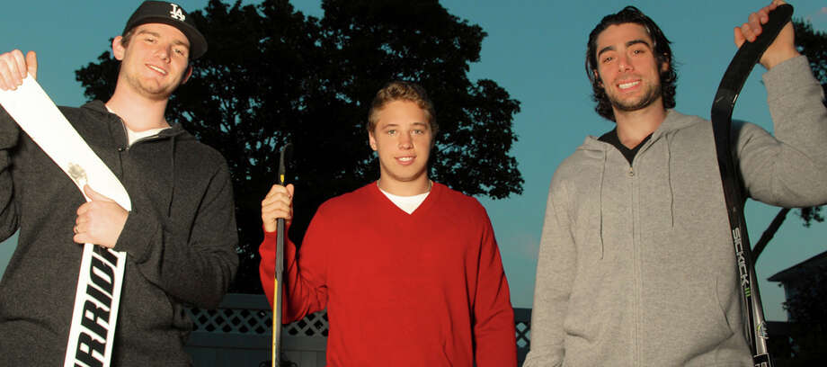 From left, Los Angeles Kings netminder and Conn Smythe Trophy winner Jonathan Quick, Columbus Blue Jackets winger and Greenwich native Cam Atkinson and Matt Moulson of the New York Islanders, photographed in the backyard of Atkinson's home in Riverside, are teaming up to do a charity event in town Aug. 19. Photo: Contributed Photo