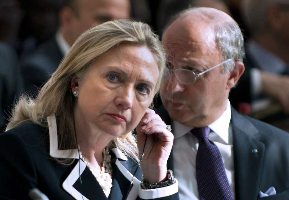 "FILE - In this July 6, 2012 file photo, U.S. Secretary of State Hillary Rodham Clinton and French Foreign Minister Laurent Fabius attend the ""Friends of Syria"" conference in Paris. The United States is readying new sanctions on Syrian President Bashar Assad's regime and its allies as Clinton heads to Turkey on Friday, Aug. 10, 2012, for weekend talks with top Turkish officials and Syrian opposition activists. (AP Photo/Brendan Smialowski, Pool, File) Photo: Brendan Smialowski"