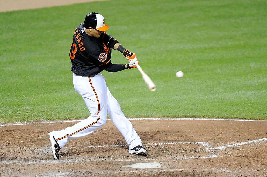 Manny Machado #13 of the Baltimore Orioles hits a home run in the sixth inning against the Kansas City Royals at Oriole Park. Photo: Greg Fiume, Getty Images