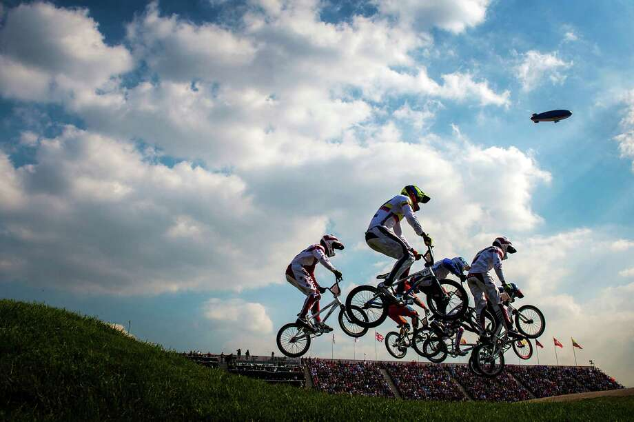 Cyclists go over a jump during the a men's BMX semifinal run at the 2012 London Olympics on Friday, Aug. 10, 2012. Latvia's Maris Strombergs won gold tin the event. Photo: Smiley N. Pool, Houston Chronicle / © 2012  Houston Chronicle
