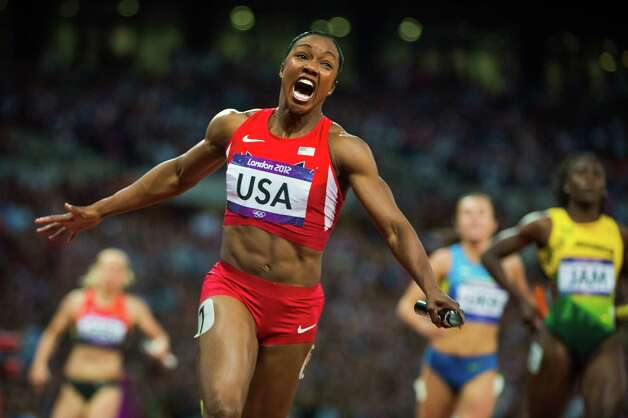 Carmelita Jeter of the USA celebrates after crossing the finish line of the 4x100m relay final at the 2012 London Olympics on Friday, Aug. 10, 2012.  Jeter anchored the relay with teammates Tianna Madison, Allyson Felix, Bianca Knight to a time of 40.82 seconds, winning the gold and breaking a world record dating back to 1985. Photo: Smiley N. Pool, Houston Chronicle / © 2012  Houston Chronicle