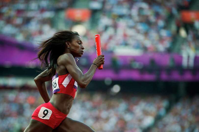 USA's Diamond Dixon takes the baton during a women's 4x400-meter relay heat at the 2012 London Olymp